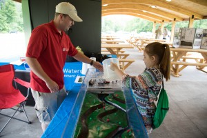 AWSMP/CCEUC Educator Brent Gotsch shows a youth the floodplain model at the Catskill Interpretive Center. Photo Credit:  Stephanie Whatton