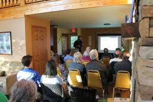 """Adam Bosch, Director of Public Affairs for the NYC Department of Environmental Protection, gives a presentation on NYC watershed infrastructure during the """"Understanding Ashokan Reservoir Operations"""" program."""