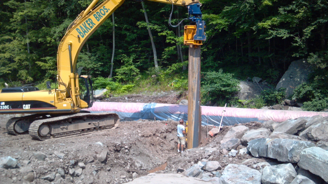 Contractors install metal sheet piling to provide grade control in the Stony Clove Creek near Silver Hollow Road. Sheet piling is the only material strong enough to stop the stream bed from eroding downward in this steep section of the stream.
