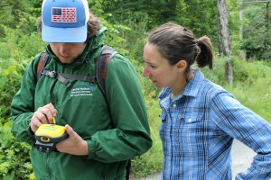 Winston Gedicks, stream assessment intern, enters data into a Trimble GPS as Tiffany Runge, AWSMP Watershed Technician with the Ulster Soil & Water District looks on, June 2017.