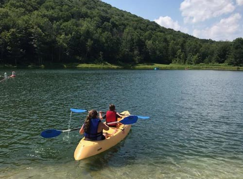 Two people kayaking on Catskill Mountain Lake