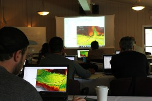 Workshop participants use digital models of the terrain to help model how rivers behave during flood events.