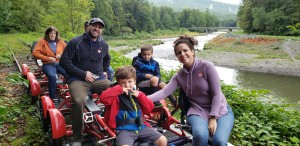 "One of the many happy families participating the ""Sunset Rail Pedal along the Esopus"" program. Photo by Chet Karwatowski"
